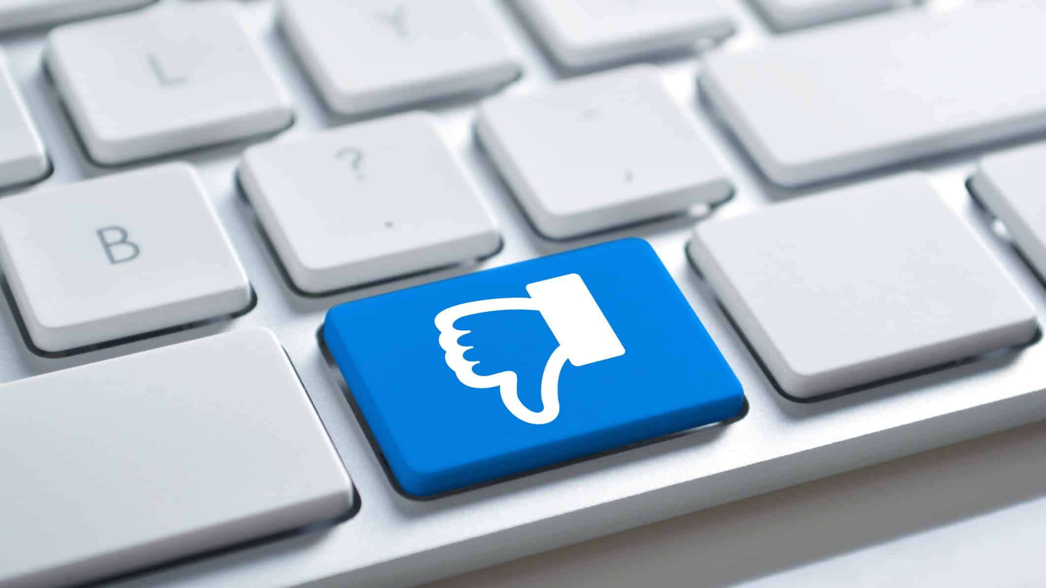 Thumbs down Facebook icon on a computer keyboard, indicating backlash against facebook's news ban in Australia