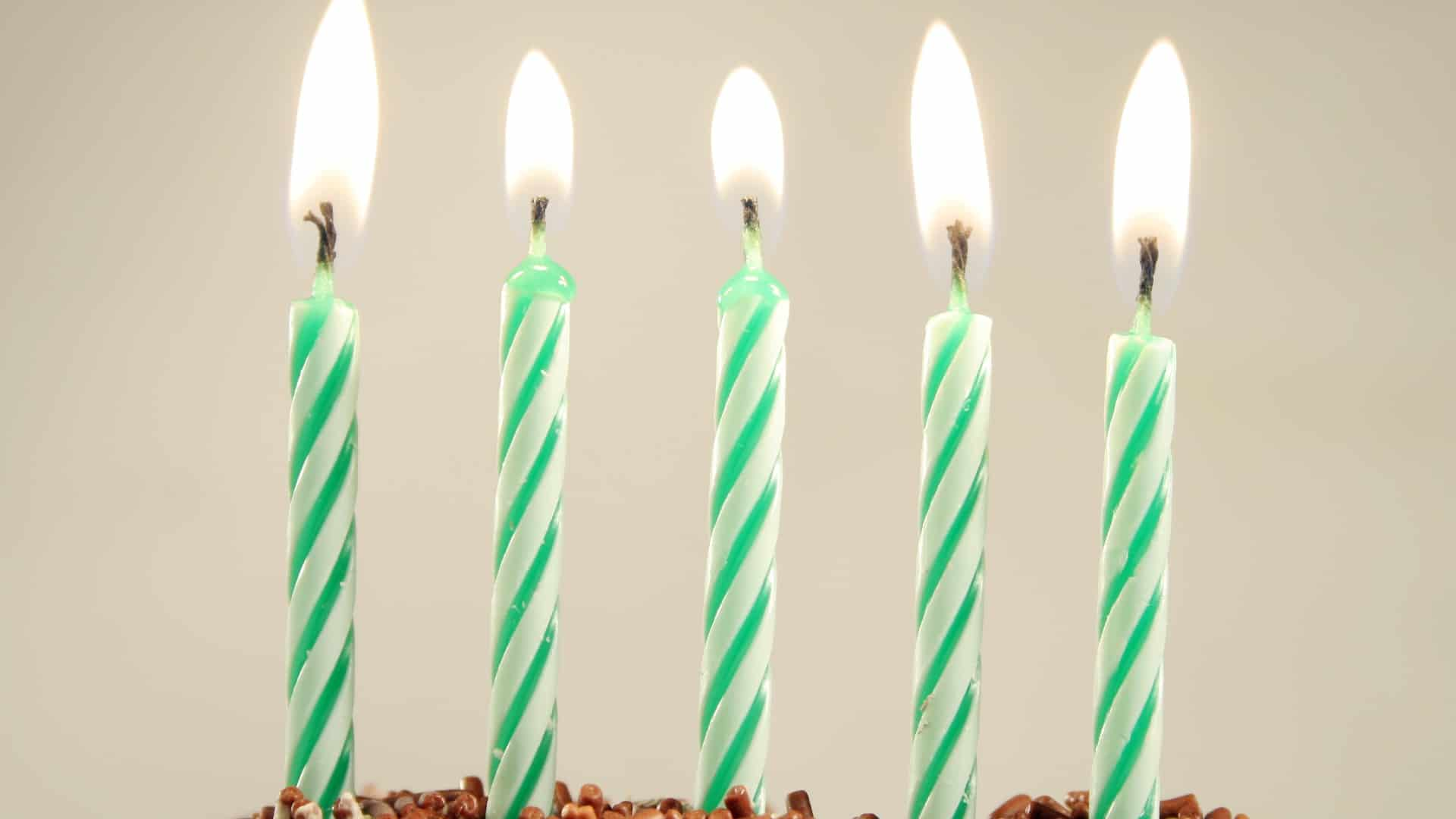 five asx shares represented by five candles on birthday cake