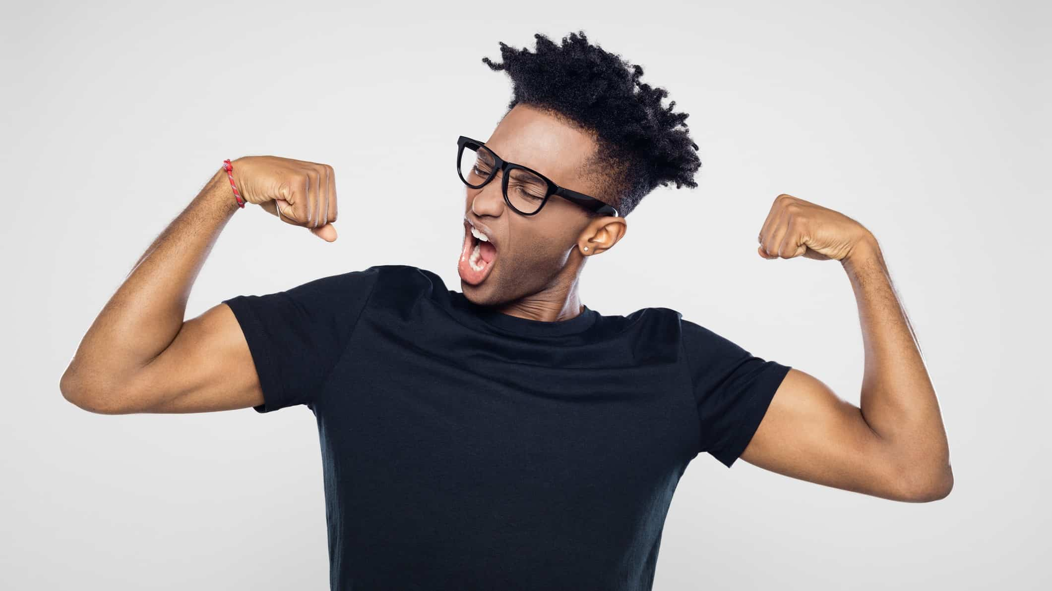 A fit man flexes his muscles, indicating a positive share price movement on the ASX market