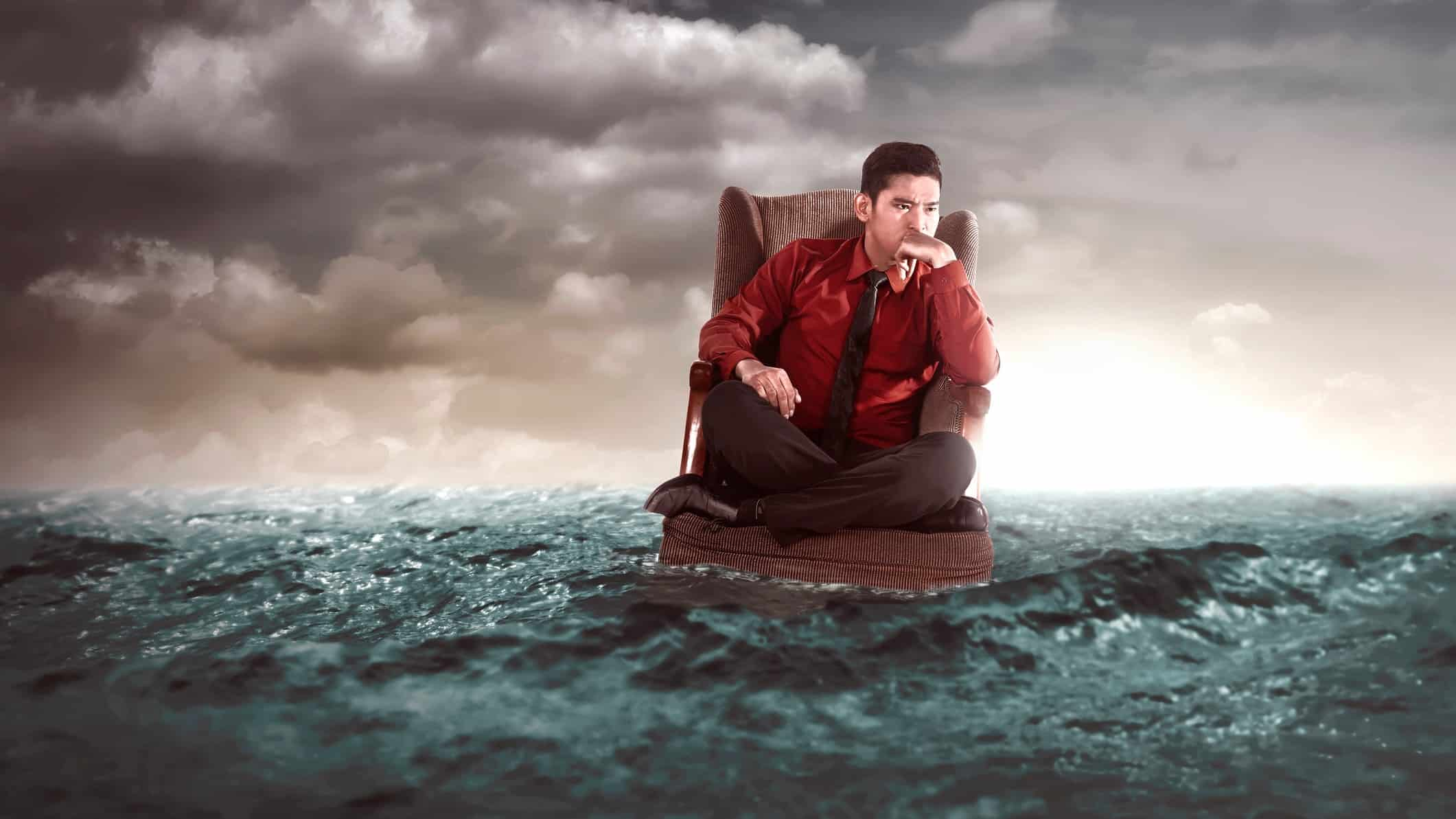 furniture asx share price represented by man in armchair floating on the sea