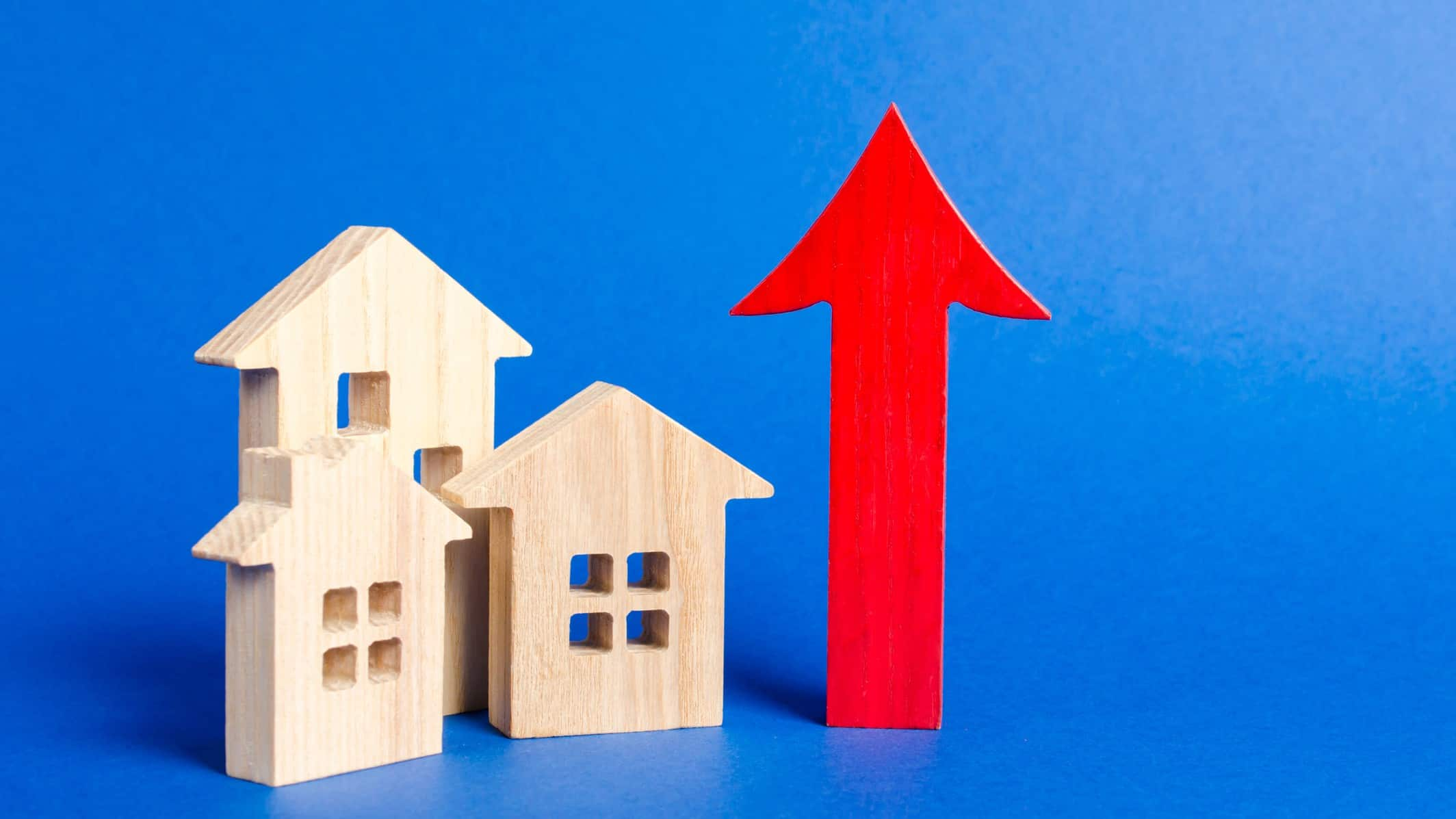 growth in housing asx shares represented by little wooden houses next to rising red arrow
