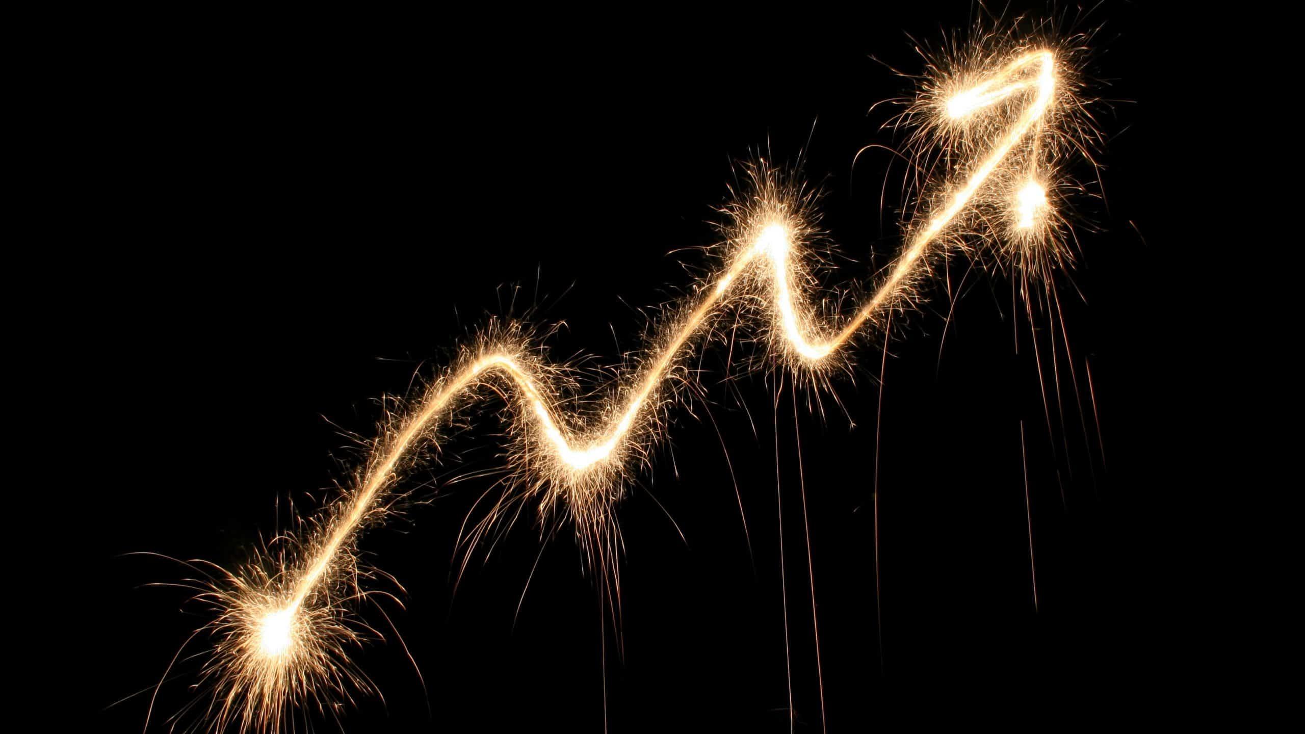 upward trending arrow made from fireworks display