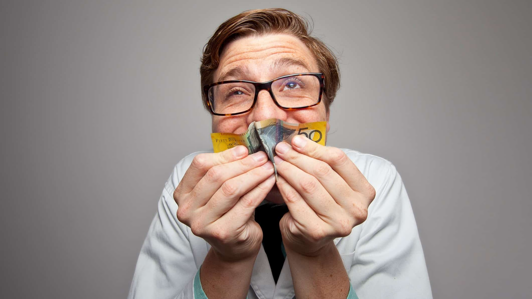 asx share price dividend payments represented by man holding $50 note close to his face