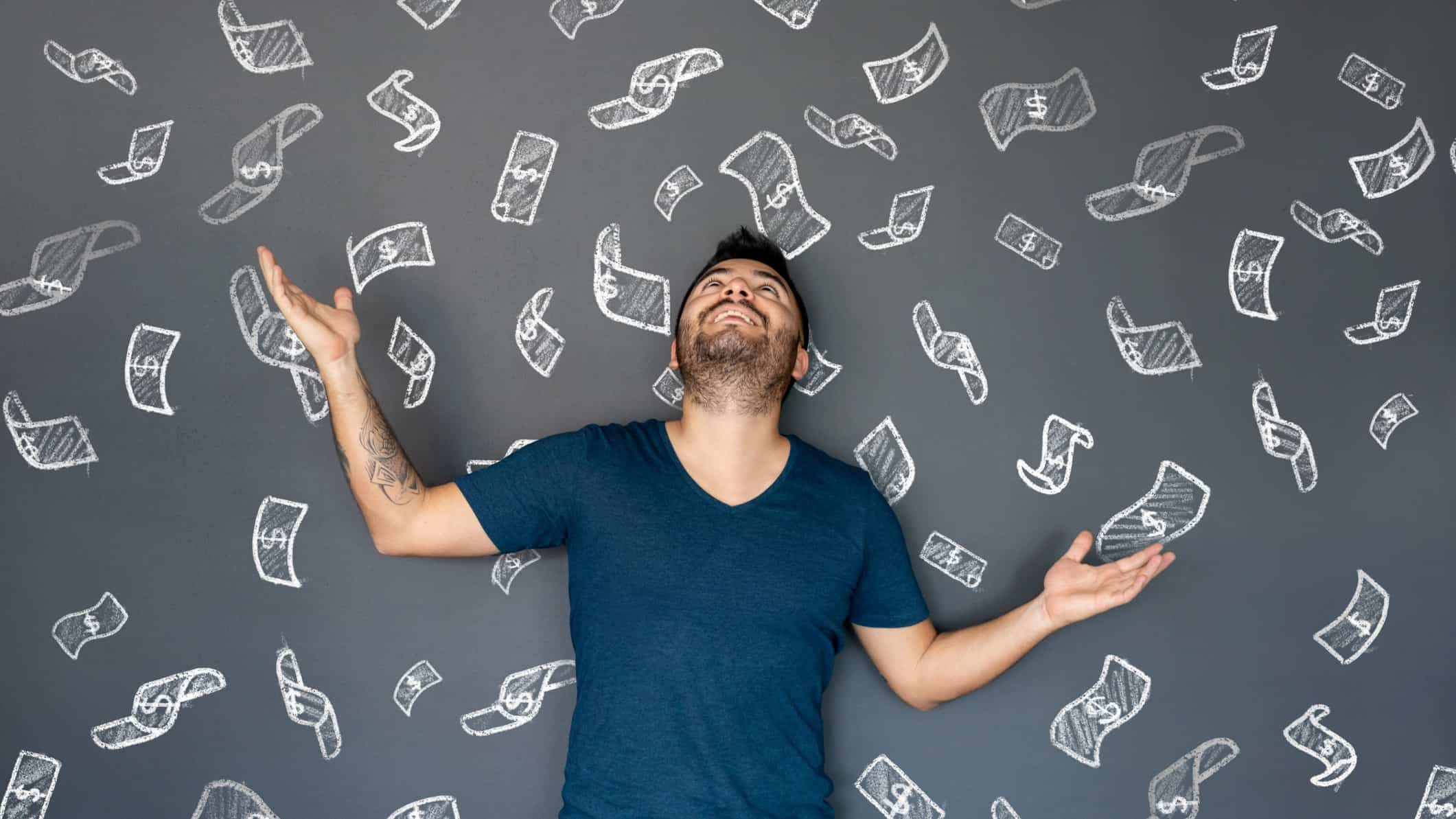rising asx share price represented by man with arms raised against blackboard featuring images of dollar notes