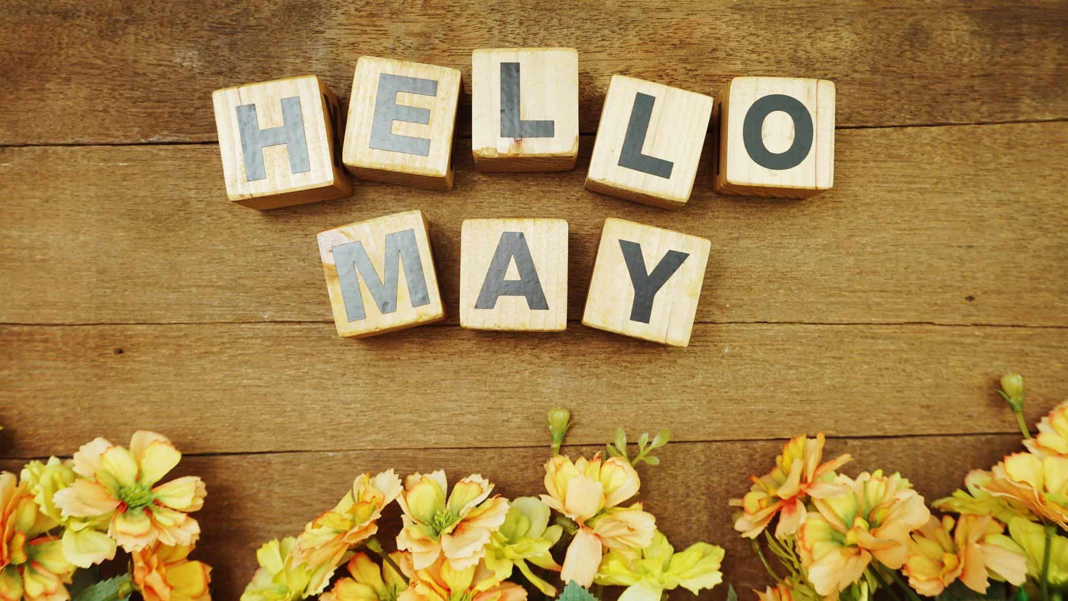 asx shares to buy in may represented by wooden blocks spelling out hello may