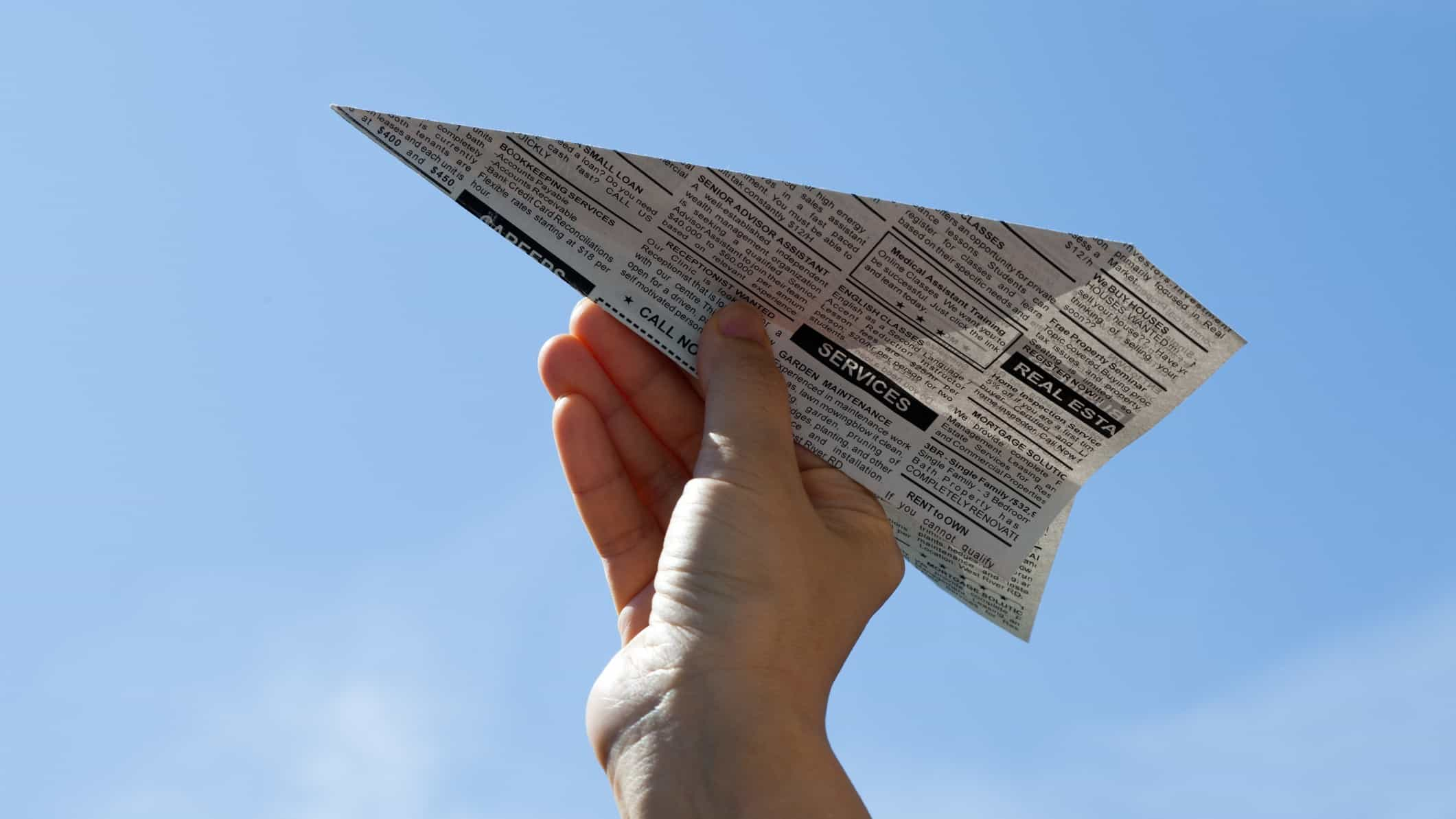 rising ASX share price represented by paper plane made from news paper