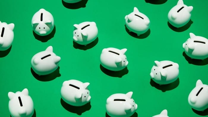 lots of piggy banks in a green background