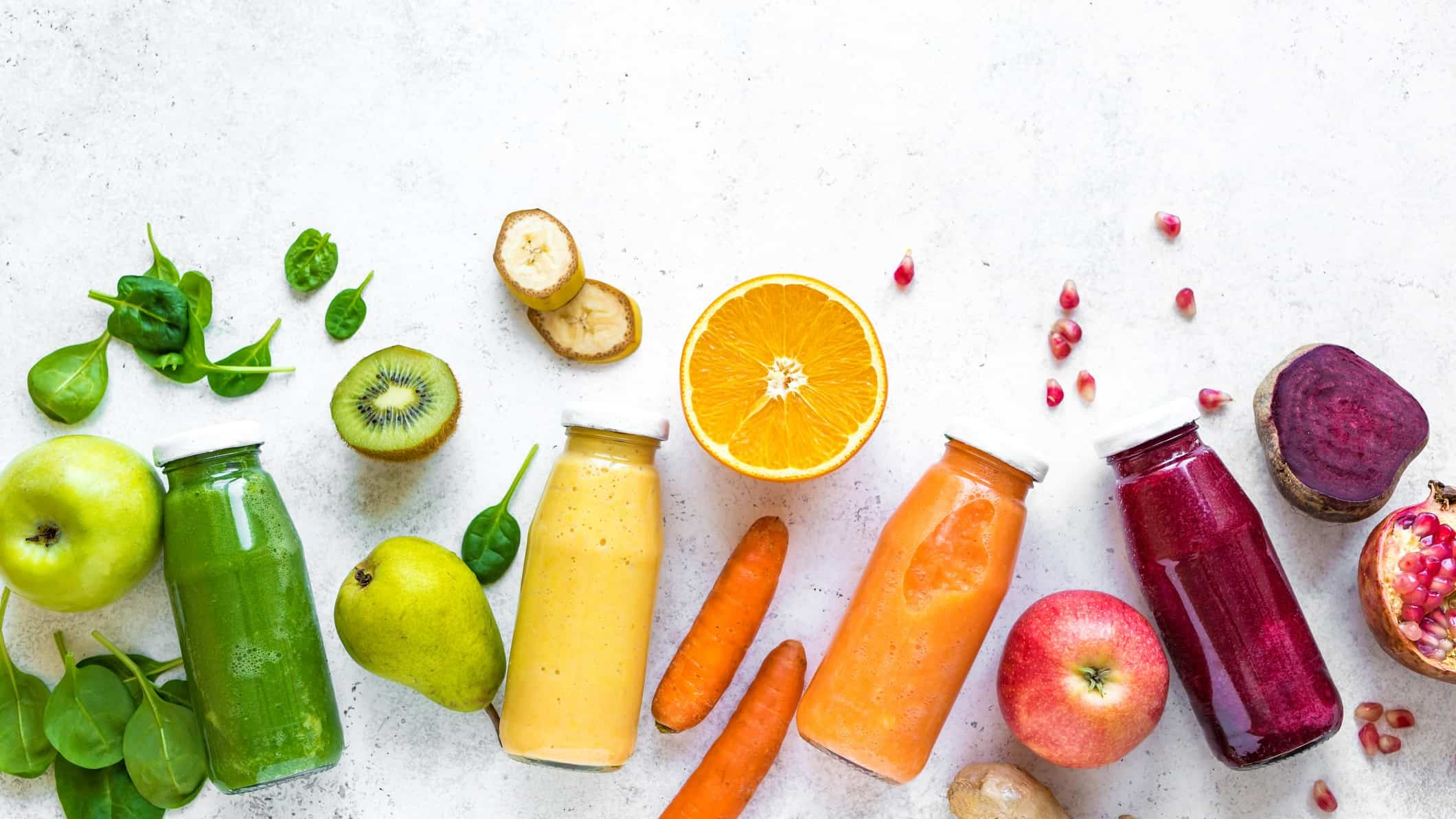 bottles of colourful plant based juices