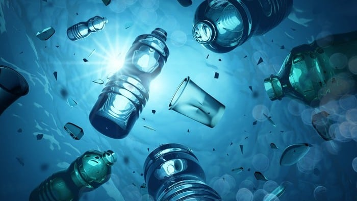 Plastic water and cola bottles floating in the sea