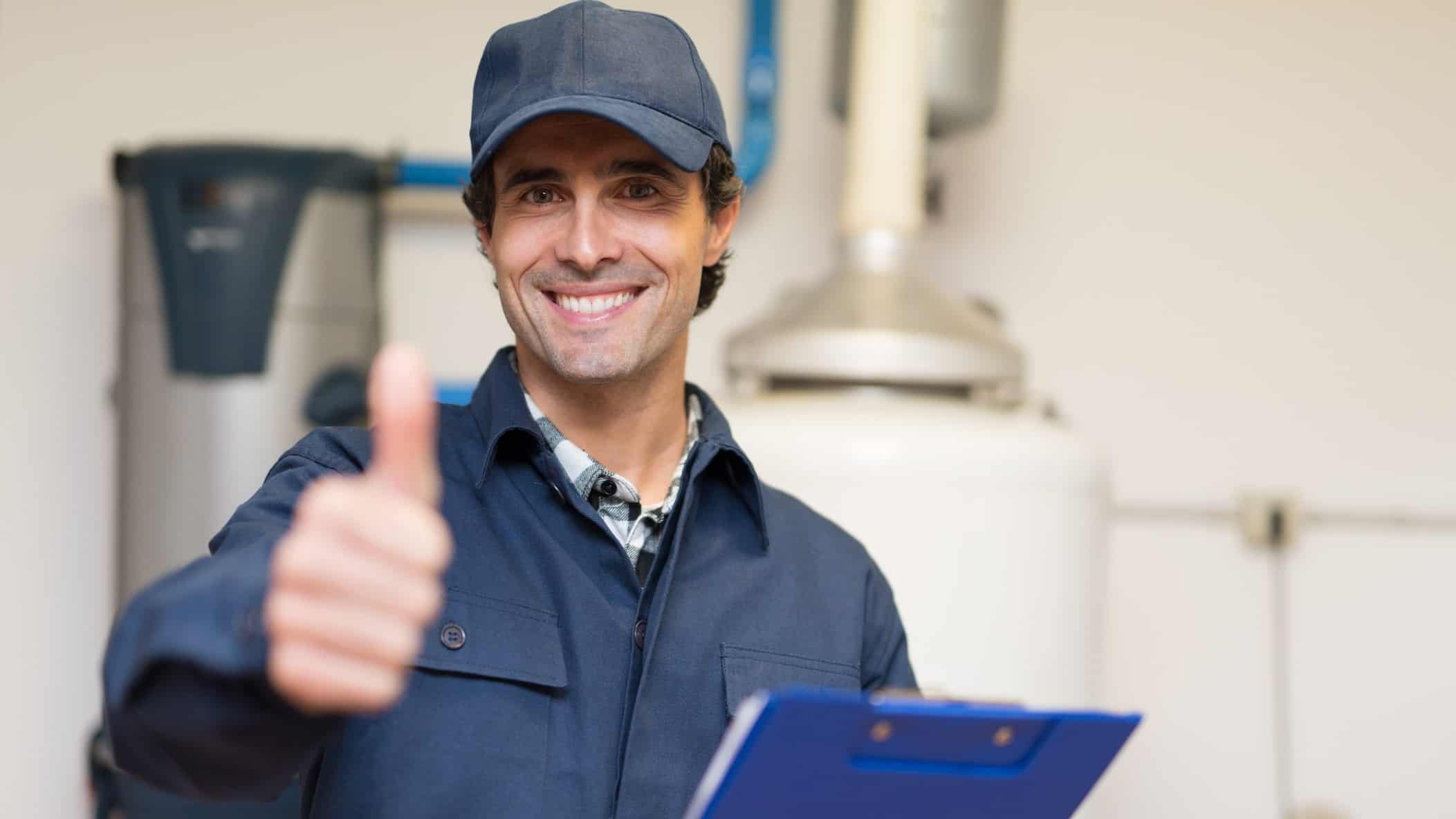 A plumber gives the thumbs up, indicating a positive share price in ASX plumbing and building