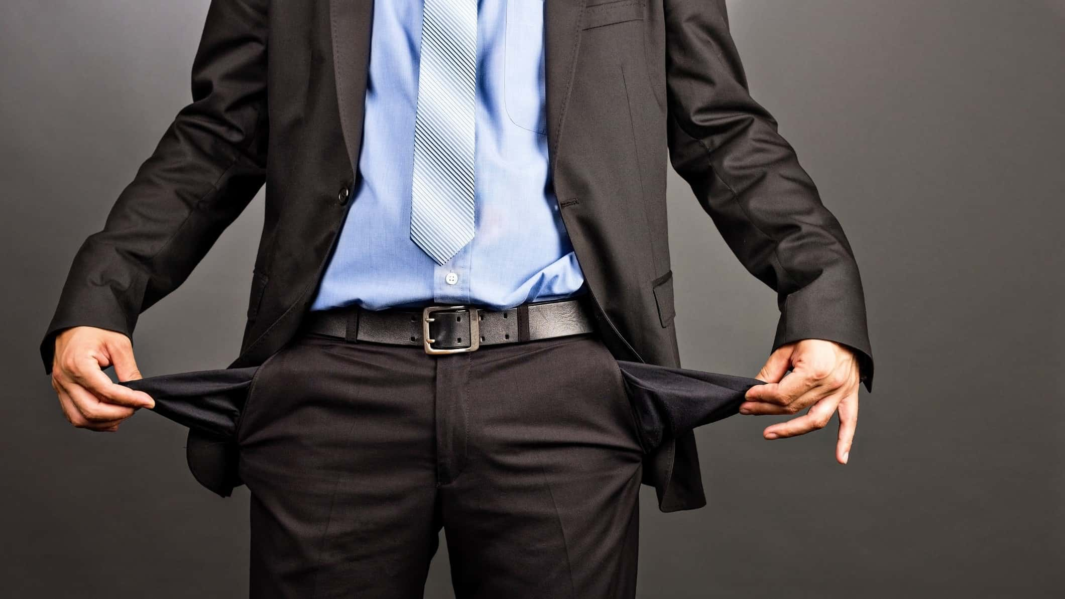 business man turning out empty pockets
