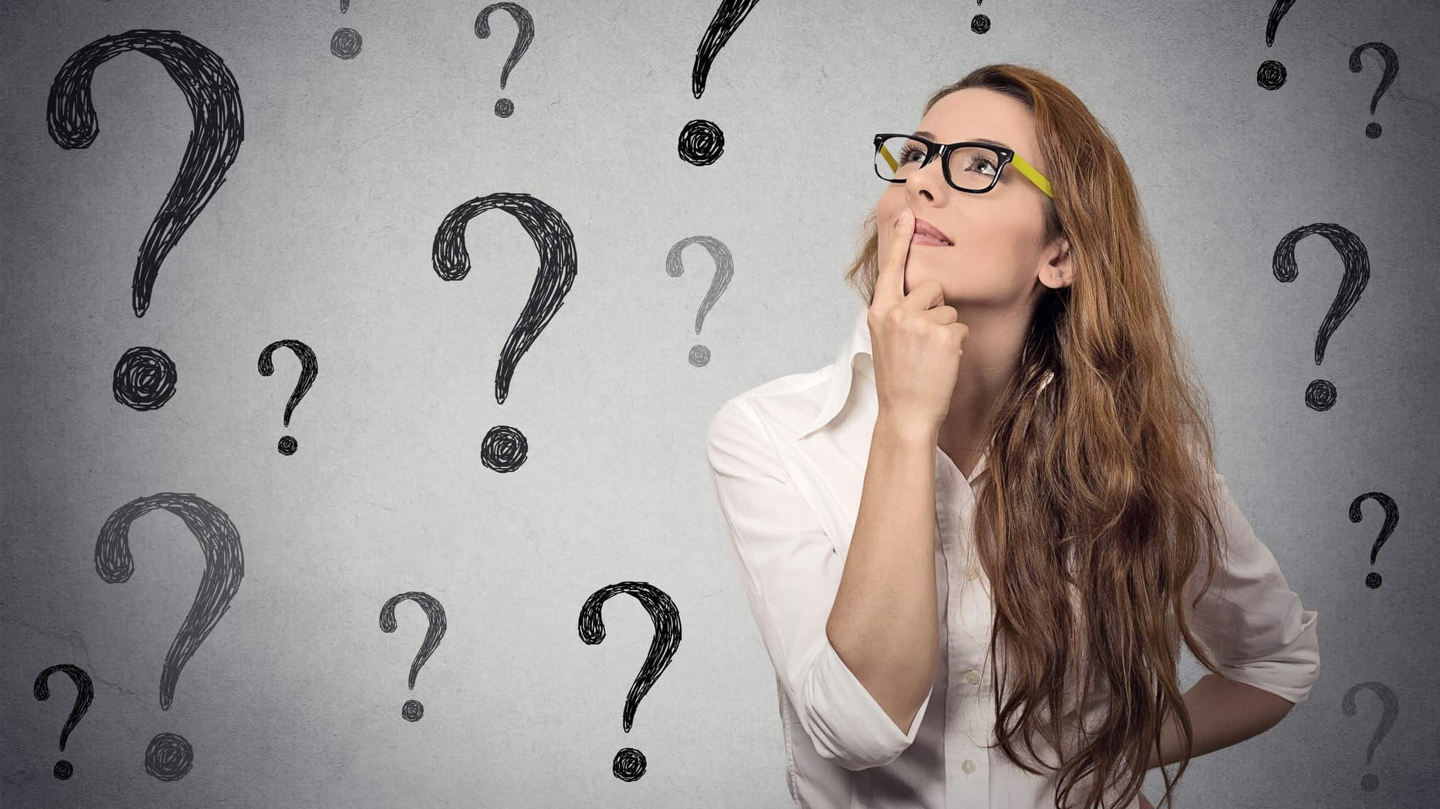 wondering about asx shares represented by woman surrounded by question marks