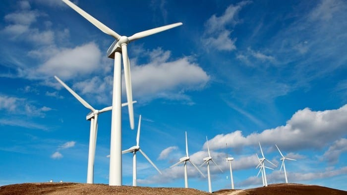 ASX renewable energy shares represented by wind turbines on a hillside