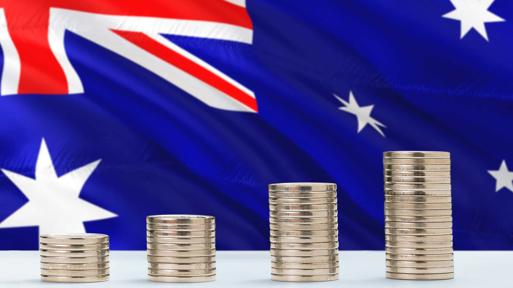 Rising asx share price represented by growing coin piles against australian flag