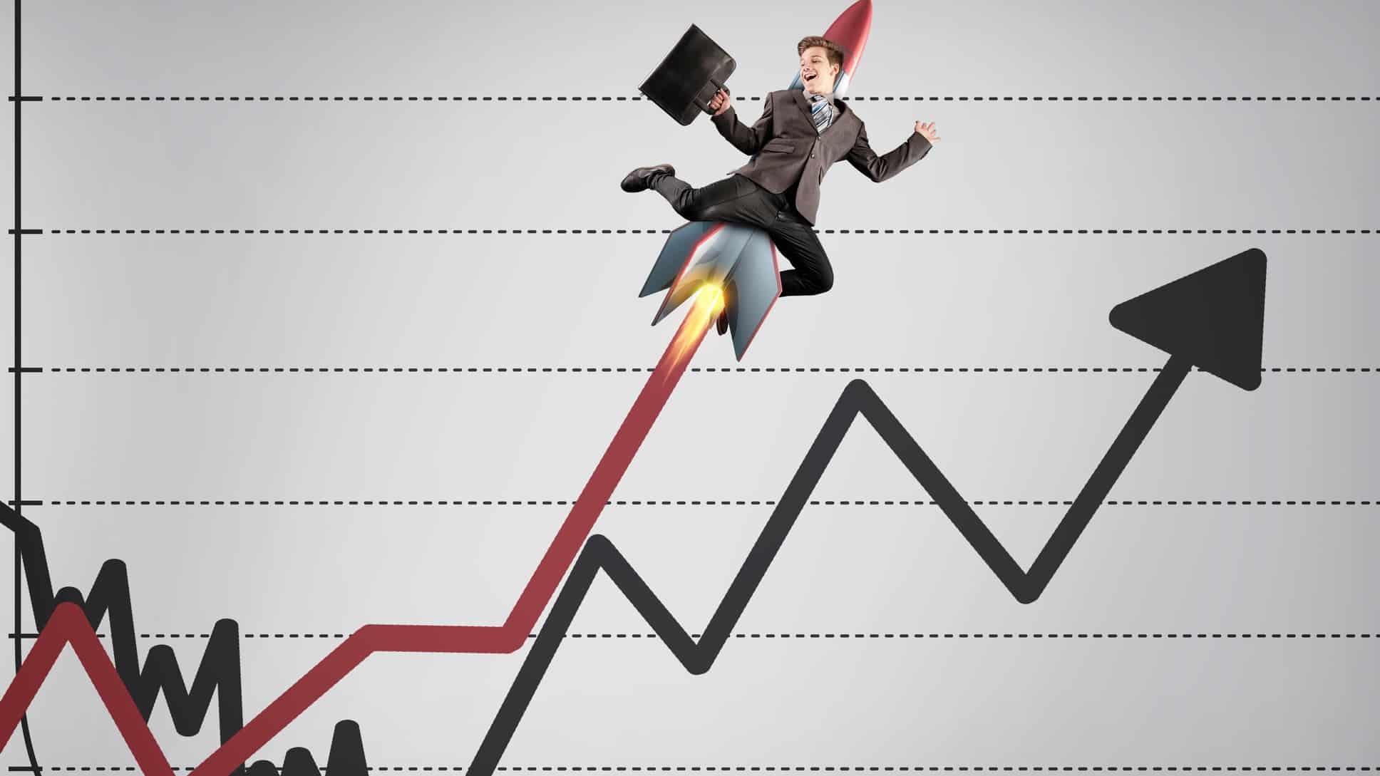 businessman riding rocket on line graph