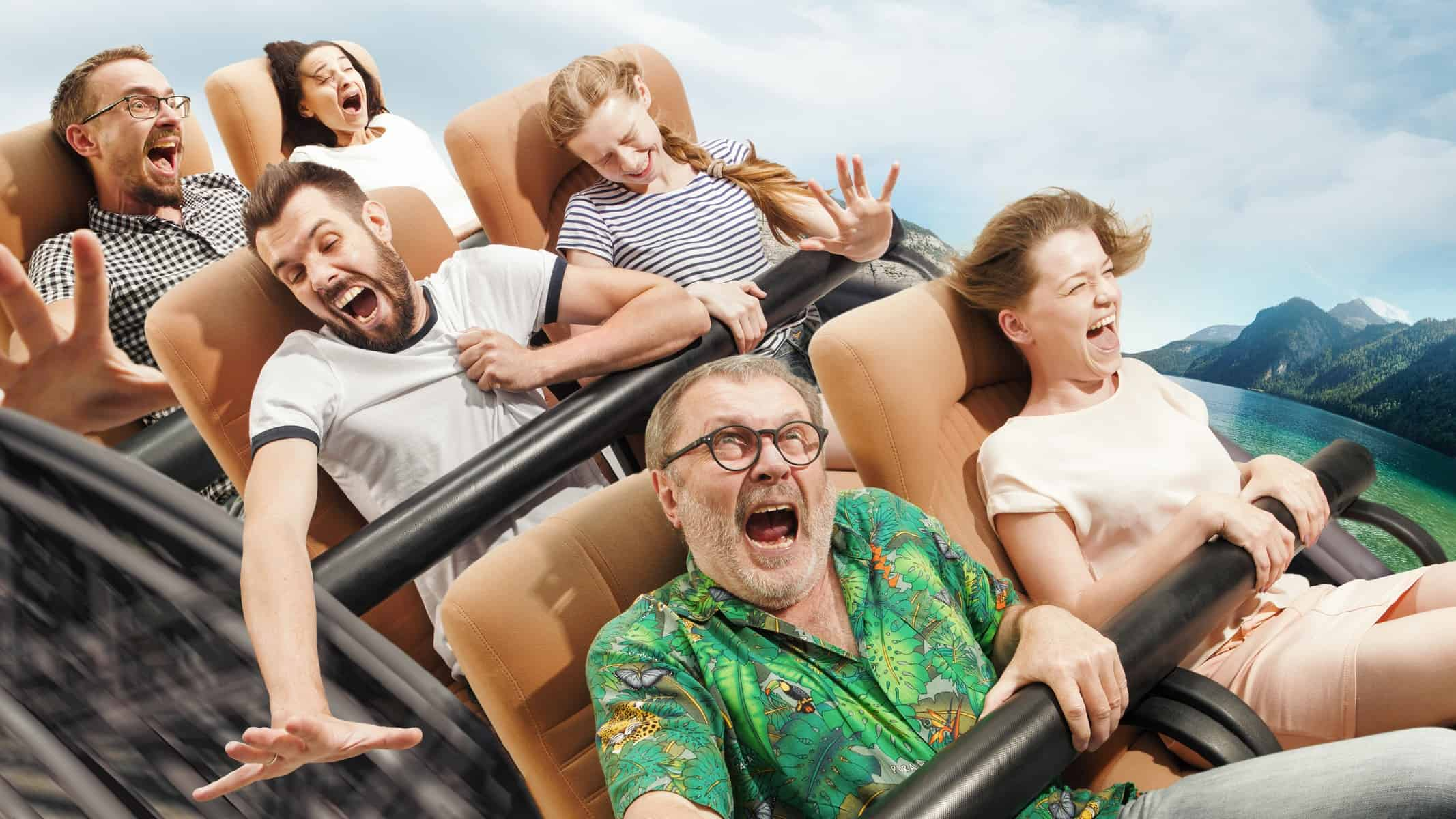 Scared people on a rollercoaster holdingon for dear life, indicating a plummeting share price
