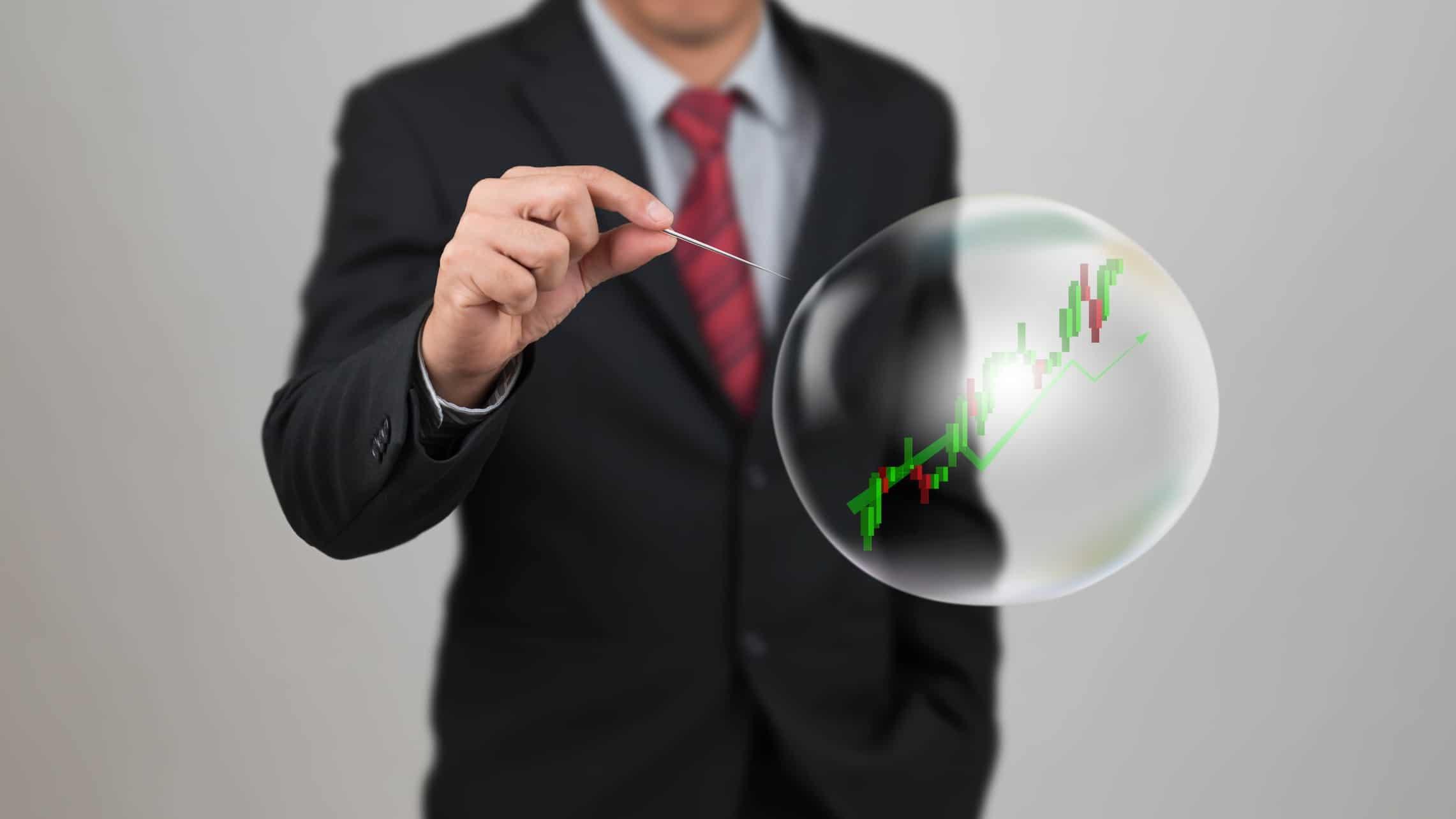 Investor pricking share market bubble