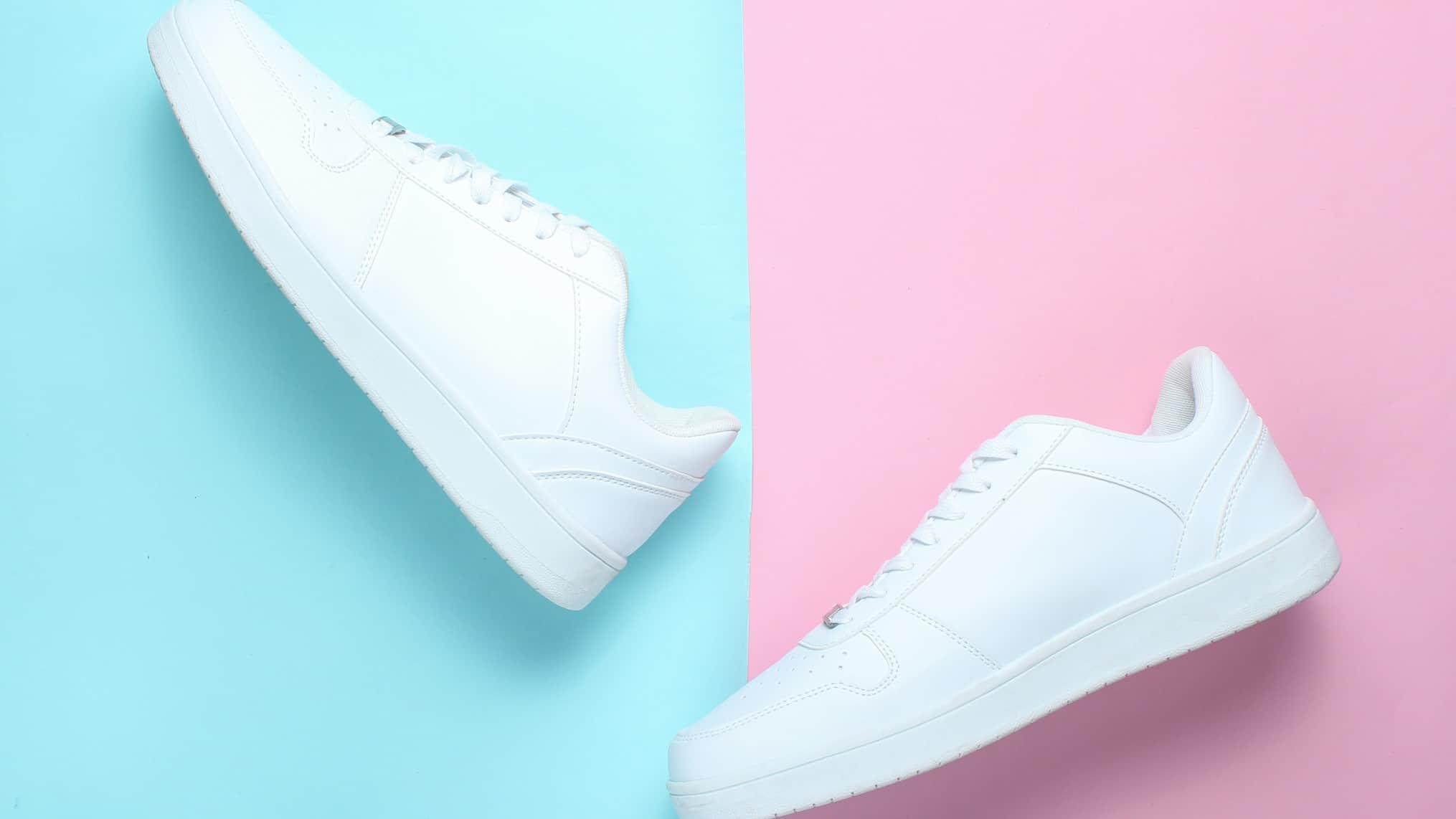 shoes asx share price represented by white shoes against pink and blue background AX1 share price downgrade