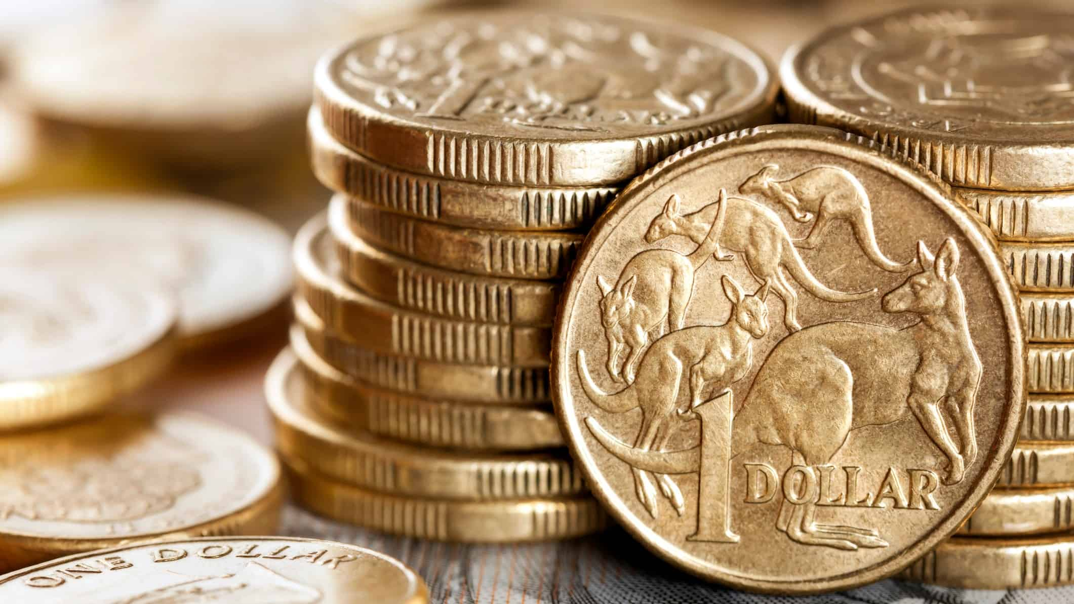 pile of one dollar coins representing asx small cap stocks