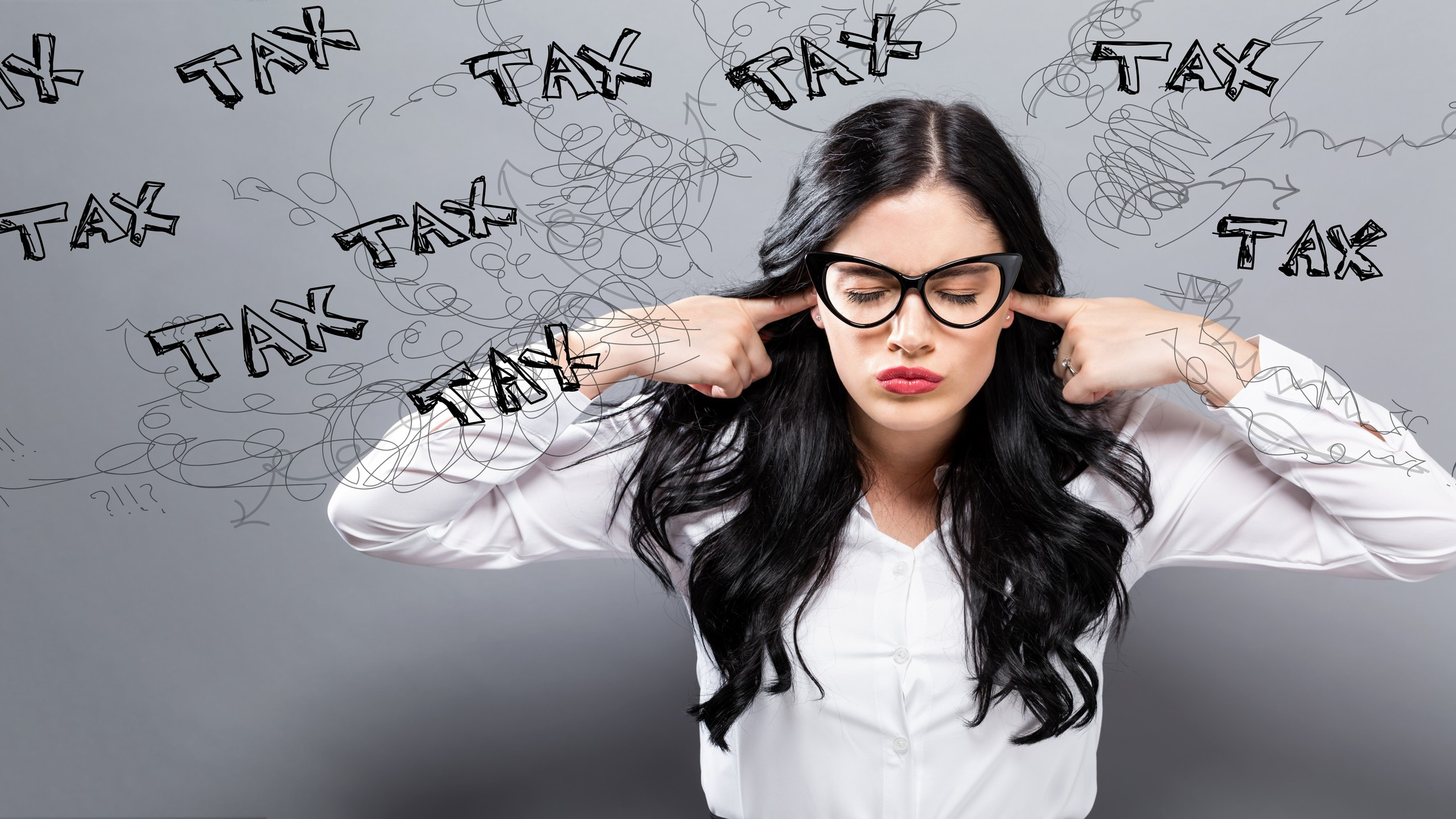 A woman with the word 'tax' scribbled around her, plugs her ears and grimaces, indicating the impact of tax on share price