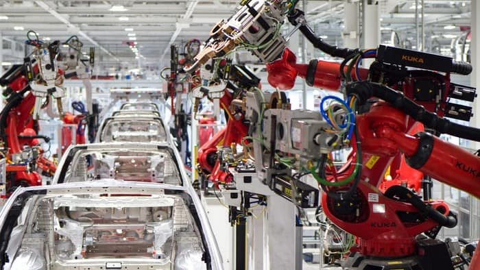 Tesla stock represented by inside of the Tesla factory at work
