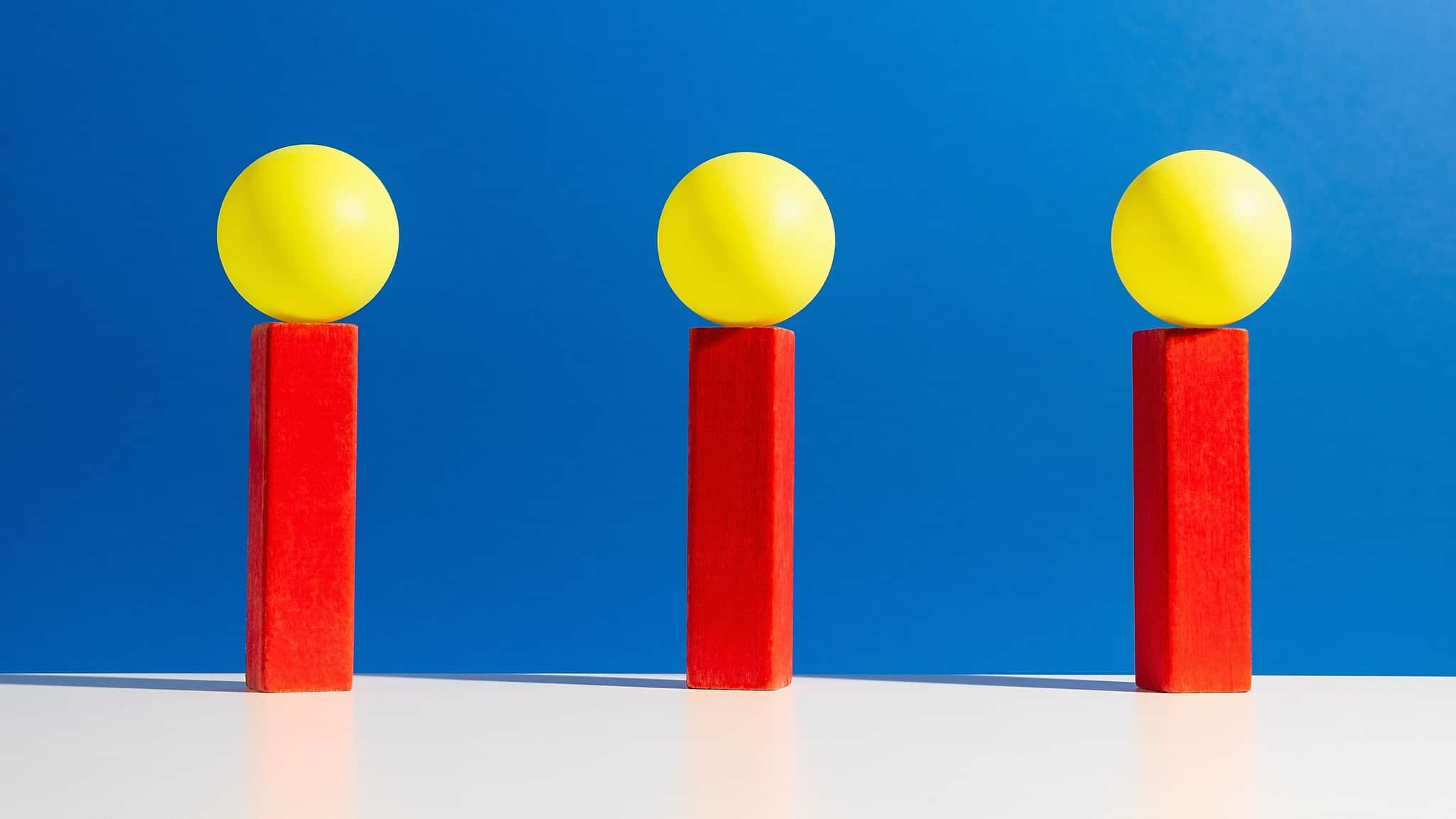 Three brightly coloured objects against a backdrop of blue, indication three winning ASX share prices