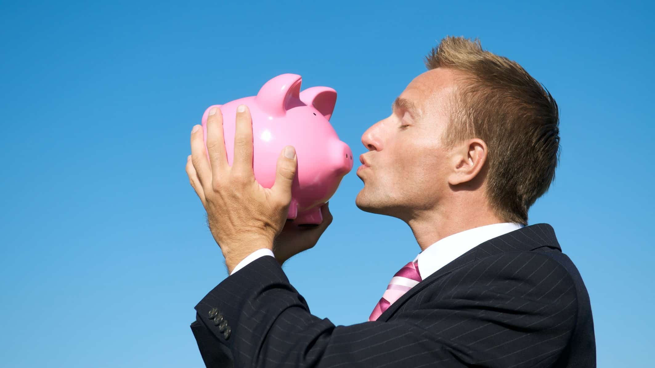 top asx shares represented by investor kissing piggy bank