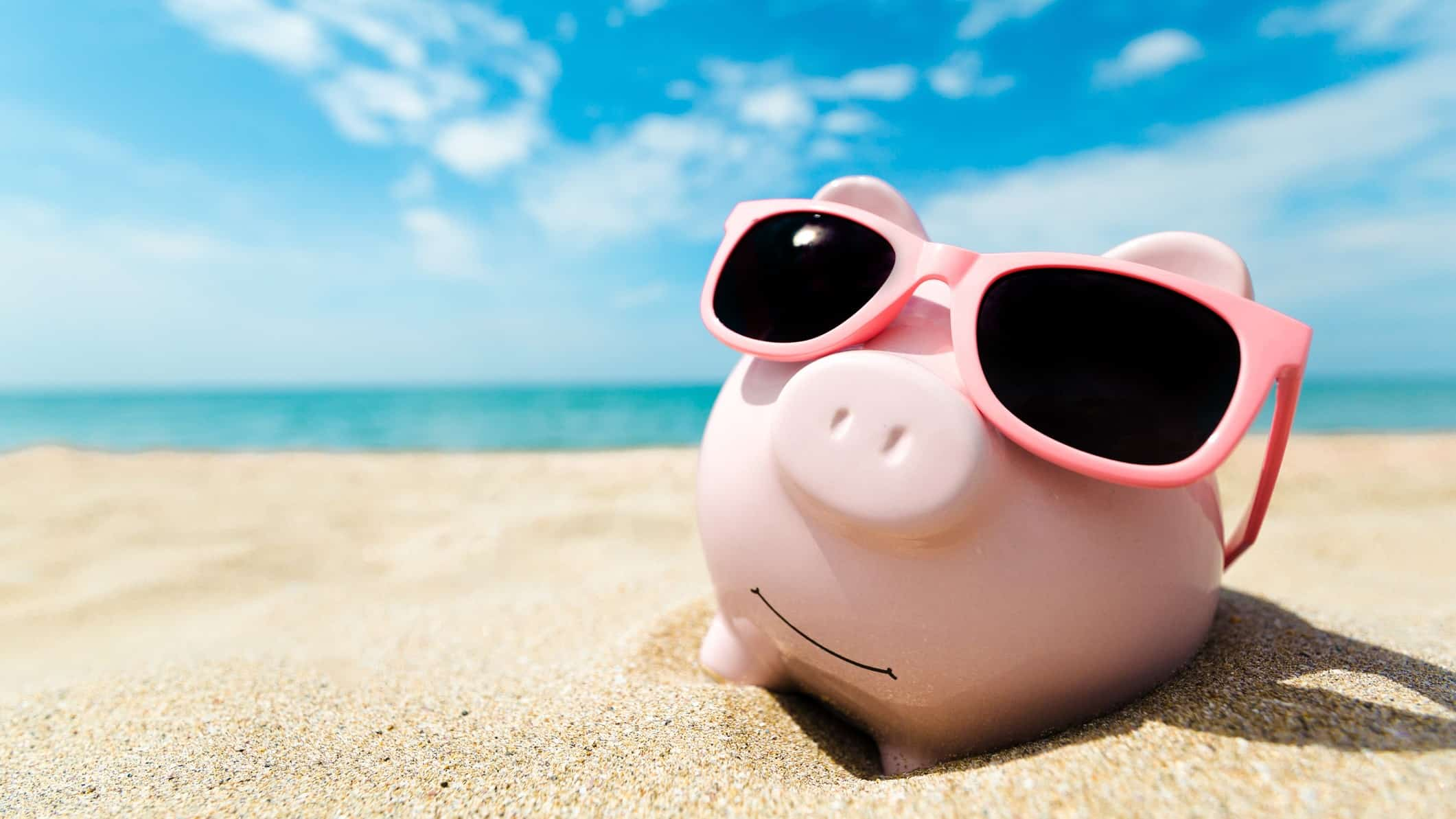top asx shares to buy in summer or to retire represented by piggy bank on sunny beach