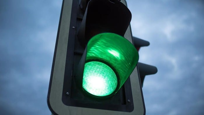 traffic light with the green light flashing