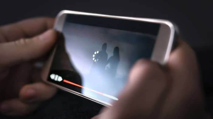 person streaming video on iphone