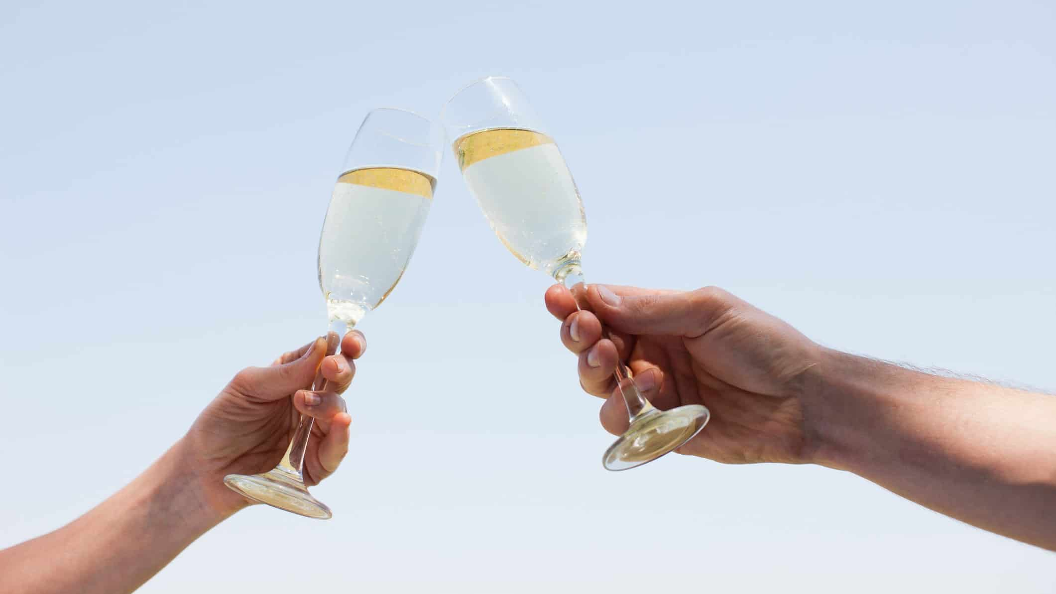 wine share price rising represented by two people raising wine glasses