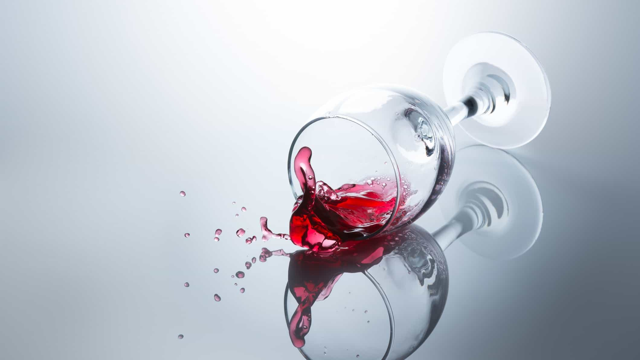 Spilled wine and a glass on its side, indicating a share price drop for ASX wine companies